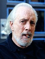 Robert Towne smoking in a cigar from a still of the movie that bears his name.