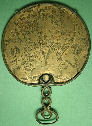 "Celtic art - The reverse side of a British bronze mirror, 50 BC - 50 AD, showing the spiral and trumpet decorative theme of the late ""Insular"" La Tène style"