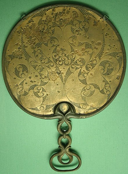 The reverse side of a British bronze mirror, with spiral and trumpet motifs typical of La Tene Celtic art in Britain Romano-Celtic mirror (Desborough).jpg