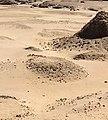 Ruins of pyramid Nuri 20 of Atlanersa (center) next to standing pyramid Nuri 2 of Amaniastabarqa.jpg