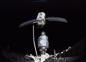 STS-88 - Endeavour, docked to Unity, moves the Zarya spacecraft into position for mating