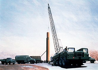 Missile launch facility - R-36 missile being lowered into a missile silo