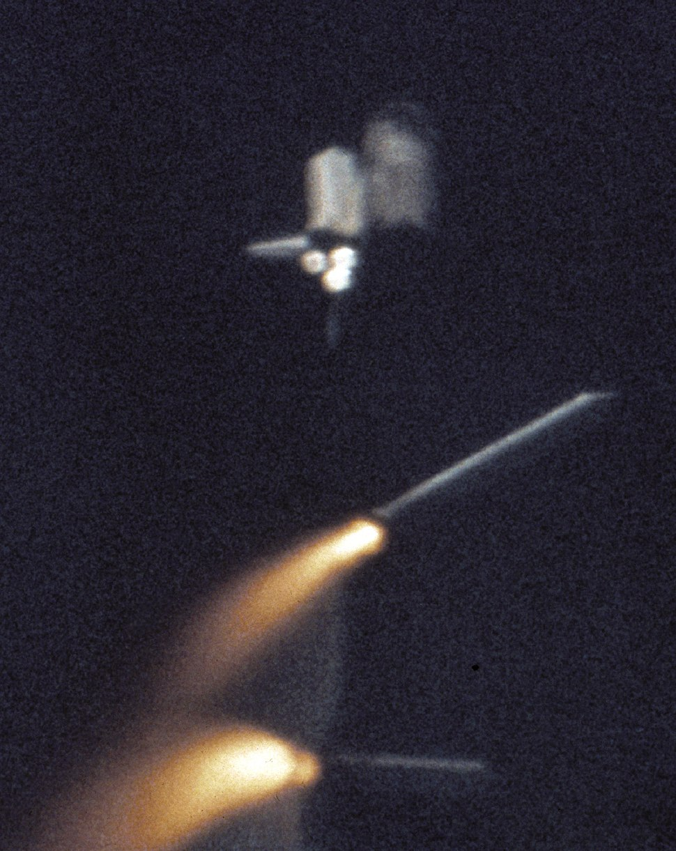 STS-1 The Shuttle's Solid Rocket Boosters break away from Columbia's External Tank
