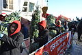 Santa's helpers unload more than 1,200 'presents' from Christmas Ship 131207-G-PL299-007.jpg