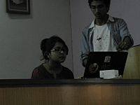 Sarbartha showing the volunteer about wikipedia.jpg