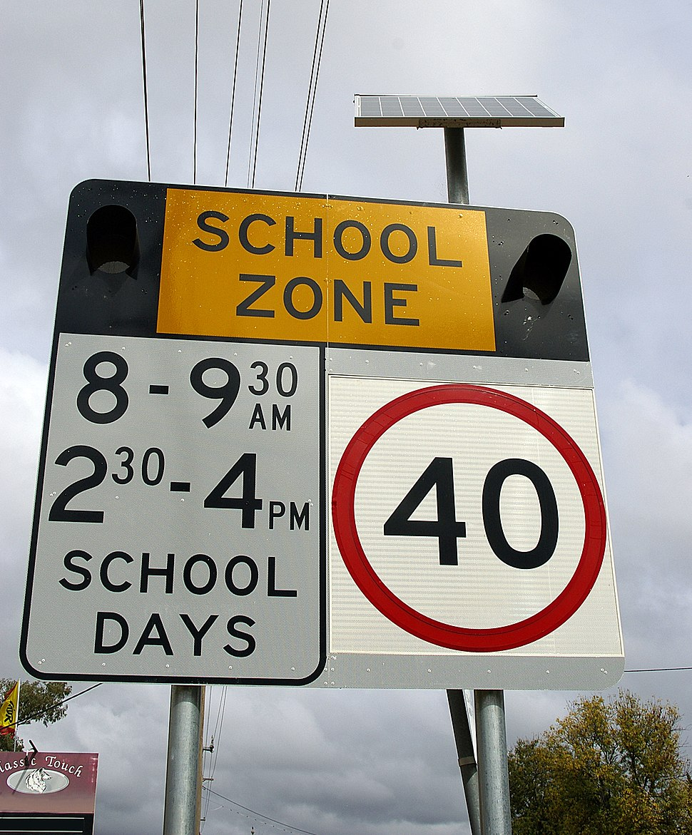School zone flashing light warning sign