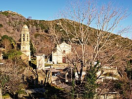 The church of San Mamilianu and the surrounding buildings, in Scolca