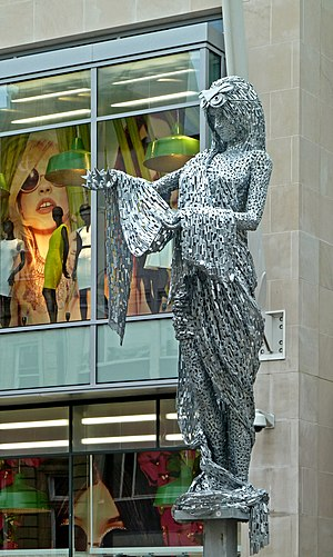 Trinity Leeds - The sculpture The Briggate Minerva, goddess of weaving and commerce, wearing an owl mask, outside the Briggate entrance of the centre.