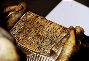 Northampton Sekhemka statue - Sekhemka holding a papyrus roll asking for offerings in the Afterlife