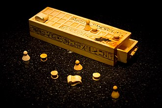 History of games - A Senet gameboard and game pieces from the KV62 tomb of Tutankhamun—originally from Thebes.