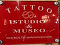 Sign at the entrance of the tattoo studio and museum of Gian Maurizio Fercioni, in Milan.jpg