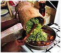 Soupou Kandja adding mashed okra.jpg
