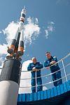 Soyuz MS-04 crew at the Soyuz rocket monument behind the Cosmonaut Hotel.jpg