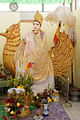 Statue of Hindu goddess Saraswati in shrine in Rangoon Burma.jpg