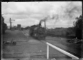 Steam locomotive pulling out of Ranfurly Station, Central Otago District. ATLIB 292333.png
