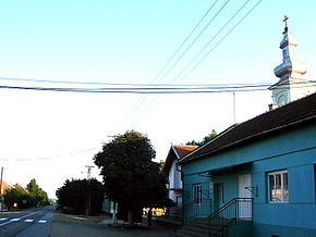 Straža, main street and Romanian Orthodox church.jpg