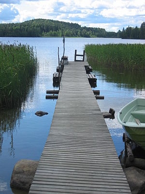 A self-made dock of a summer cottage at a lake...