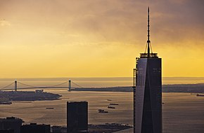 One World Trade Center seen at sunset; the Verrazzano-Narrows Bridge is in the background