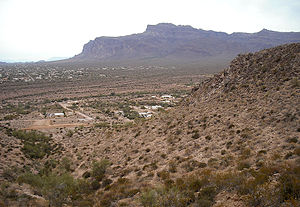 East Valley (Phoenix metropolitan area) - Superstition Mountain (background) and part of Apache Junction, as seen from Superstition View Trail (foreground) on Silly Mountain in the East Valley.