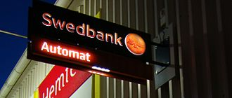 Swedbank - Swedbank sign above an automated teller machine in Karlskrona.