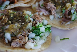 Mexican street food - Tacos with carnitas in Los Angeles