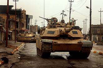 Iraqi insurgency (2003–11) - U.S. Army M1A2 Abrams tanks patrol the streets of Tal Afar, Iraq in February 2005.