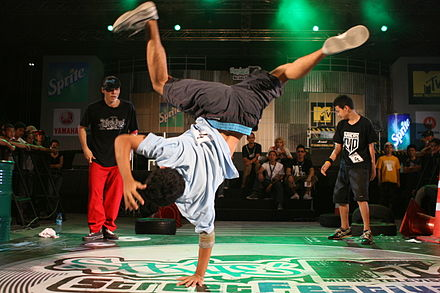 Breaking, an early form of hip hop dance, often involves dance battles, showing off technical skills, trying to out-do a rival dancer, and displaying tongue-in-cheek bravado. Thai Breakdancers.jpg