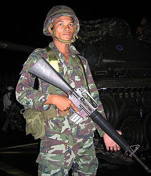 Royal Thai Army soldier armed with M16A2 stand...