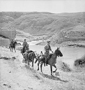 Cheshire Yeomanry - The Cheshire Yeomanry patrolling on horseback at Marjuyan in Syria, 16 June 1941. (IWM E3593)