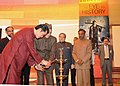 "The King of Bhutan, HM Jigme Khesar Namgyel Wangchuck lighting the lamp to inaugurate the Photo Exhibition ""BHUTAN An Eye to History"", in New Delhi on December 23, 2009.jpg"