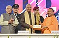 The President, Shri Ram Nath Kovind being felicitated by the Chief Minister of Uttar Pradesh, Yogi Adityanath, at the Concluding Session of the UP Investors Summit 2018, at Lucknow, in Uttar Pradesh.jpg