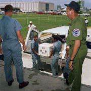 The first Apollo 11 sample return container is unloaded