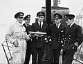 The officers of HM Submarine SERAPH on her return to Portsmouth after operations in the Mediterranean, 24 December 1943. A21112.jpg