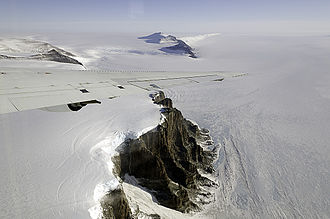 Theron Mountains - The tip of the NASA DC-8's wing cuts across a dramatic view of Antarctica's Theron Mountains on Oct. 21, 2011