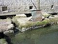 Tibet-6012 - Water Entrance of barley grinding mill powered by water for grinding Tibetan native barley into tsampa.jpg