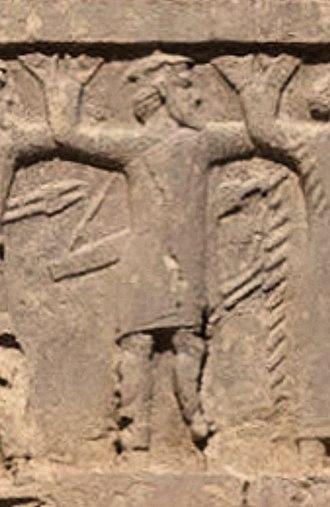 "Achaemenid Macedonia - ""Ionian with shield-hat"" on the tomb of Darius II (circa 410 BC)."