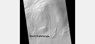 Hellas Planitia - Tongue-shaped glacier in Hellas Planitia. Ice may still exist there beneath an insulating layer of soil.