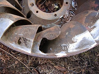 Water turbine - A Francis turbine at the end of its life showing pitting corrosion, fatigue cracking and a catastrophic failure. Earlier repair jobs that used stainless steel weld rods are visible.