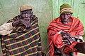 Turkana herders sheltering from rain - Marti, Kenya.jpg