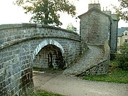 A bridge over the old course of the Lancaster Canal, now used as a footpath