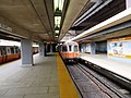 Two trains at Sullivan Square station, August 2018.JPG