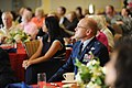U.S. Air Force Brig. Gen. Andrew Mueller, center, the 81st Training Wing commander, watches a Mississippi Special Olympics Summer Games video with guests during the Biloxi Chamber of Commerce Morning Call at 110831-F-BD983-006.jpg