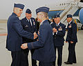 U.S. Air Force Col. Mike Minihan, vice commander of the 60th Air Mobility Wing (AMW), greets Lt. Gen. Paul J. Selva, assistant to the chairman of the Joint Chiefs of Staff, upon his arrival at Travis Air Force 100111-F-WV915-008.jpg