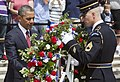 U.S. Army Sgt. 1st Class Tanner Welch, right, assigned to the 3rd U.S. Infantry Regiment (The Old Guard), helps President Barack Obama lay a wreath during the 145th annual Memorial Day ceremony at the Tomb 130527-D-HU462-155.jpg