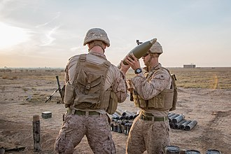 3rd Battalion, 4th Marines loading 120mm mortar rounds during Operation Inherent Resolve in Syria, 2018 U.S. Marines with 3rd Battalion, 4th Marines.jpg