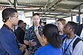 U.S. Navy Capt. Kevin P. Lenox, center, the commanding officer of the amphibious transport dock ship USS Denver (LPD 9), gives an interview to Timorese journalists during the opening ceremony reception for 130828-N-KL846-062.jpg