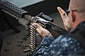 U.S. Navy Master-at-Arms 2nd Class James Parker loads an M240 machine gun during a weapons qualification aboard the aircraft carrier USS Harry S. Truman (CVN 75) in the Gulf of Aden Aug. 25, 2013 130825-N-DV340-001.jpg