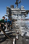 U.S. Sailors and Marines scrub the flight deck of the aircraft carrier USS Harry S. Truman (CVN 75) March 9, 2014, in the Gulf of Oman 140309-N-VE959-210.jpg