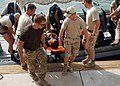 U.S. and Dutch sailors carry a simulated injured diver during a mock mine diving rescue exercise in support of Mine Countermeasures Exercise (IMCMEX) 2013 in Manama, Bahrain, May 16, 2013 130516-N-QS318-004.jpg
