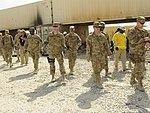 U.S. military senior logistics personnel walk through the Defense Logistics Agency Disposition Services yard at Bagram Airfield in Parwan province, Afghanistan, June 27, 2013, to review operations and identify 130627-A-ZT122-094.jpg
